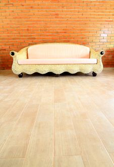 Free Brick Wall With A Rattan Sofa Stock Photography - 17374242