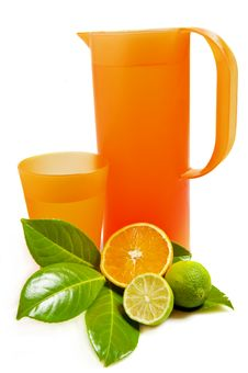 Pitcher And Glass With Orange And Lime Royalty Free Stock Photography