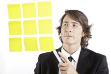 Free Young Businessman Looking At Postit Reminder Notes Stock Photo - 17375960