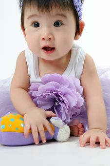 Free Kid In Purple Dress Stock Images - 17378114