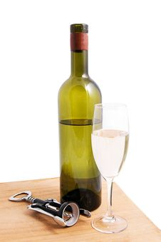 White Wine Bottle And Glass With Corkscrew Royalty Free Stock Photo