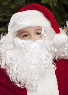 Free Thoughtful Boy Dressed As Santa Claus Royalty Free Stock Photography - 17381487