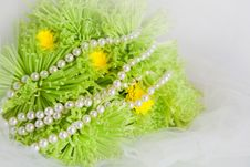 Necklace Of Pearls And Bouquet Of Chrysanthemums Royalty Free Stock Image