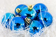 Christmas Ball In Tinsel Stock Images