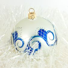 Christmas Ball In Tinsel Royalty Free Stock Photography