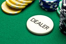 Poker Dealer Button And Chips Stock Photos