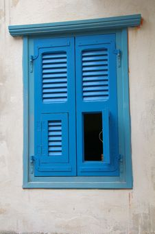 Unusual Blue Window Shutters Stock Photos