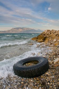 Free Lorry Tyre On Sea Shore - Pollution Stock Images - 17387994