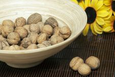 Wooden Bowl With Walnuts On Mat Royalty Free Stock Photos