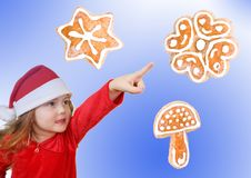 Free Little Girl In Christmas Hat Pointing Royalty Free Stock Photo - 17391095