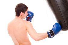 Free Man Beats A Boxing Bag Stock Photo - 17393080