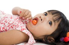 Free Cute Little Girl With A Lollipop Royalty Free Stock Photography - 17394297