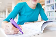 College Student In A Library Stock Images