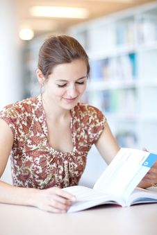 Free College Student In A Library Royalty Free Stock Image - 17396526