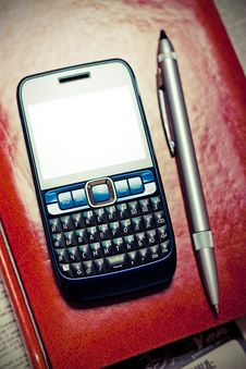 Free Phone Lying On The Diary Royalty Free Stock Image - 17397006