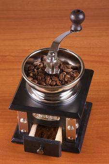 Coffee Mill With Roasted Beans Stock Photo