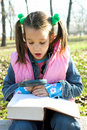Free Little Pretty Child Reading The Book Stock Photos - 1744853