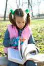 Free Little Pretty Child Reading The Book Royalty Free Stock Image - 1744886
