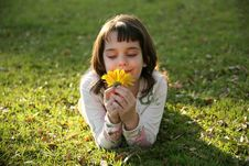 Free Girl Looking At A Flower Royalty Free Stock Photo - 1743375