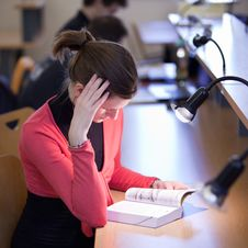 Free Female College Student In A Library Stock Photography - 17401092