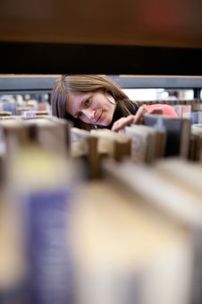 Free College Student In A Library Stock Photo - 17401530