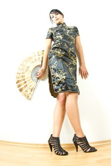 Woman In Chinese Dress With Fan Royalty Free Stock Photography