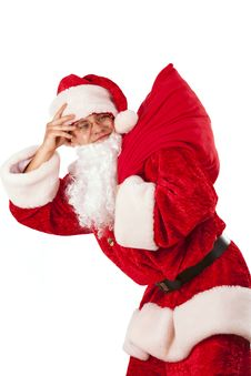 Santa Clause Carrying A Heavy Sack Stock Photography