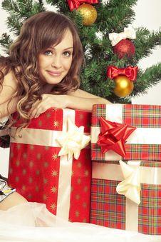 Free Girl With Gift Boxes Royalty Free Stock Photography - 17405537
