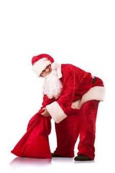 Santa Clause Carrying A Heavy Sack Royalty Free Stock Photos