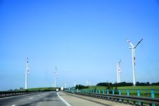 Free Highway And Wind Turbines In The Foreground Royalty Free Stock Image - 17407146