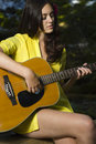 Free Young Woman Playing Guitar Royalty Free Stock Images - 17416649