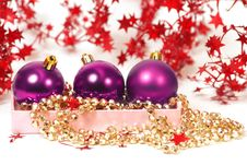 Three Chrispmas Purple Balls Stock Images