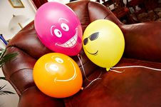 Free Three Fanny Balloons On Brown Chair Stock Photos - 17416903