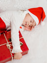 Free The Child Sleeps Near To A New Year S Gift Stock Image - 17425471