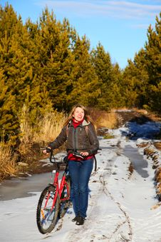 Free Woman With Bicycle On Nature Royalty Free Stock Photos - 17423678