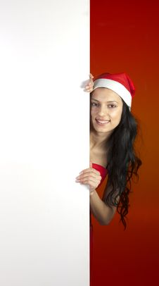Free Sexy Christmas Woman Holding A Sign Royalty Free Stock Image - 17424396