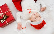 Free The Child Sleeps Near To A New Year S Gift Stock Image - 17425421