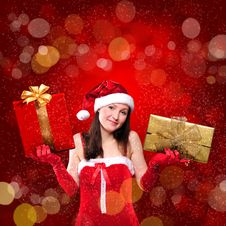Portrait Of A Young Girl Dressed As Santa Claus Stock Photos