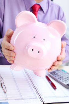 Free Businessman With A Pig Bank Royalty Free Stock Images - 17427669
