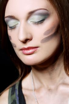 Attractive And Sexy Girl Have Military Makeup Stock Photography