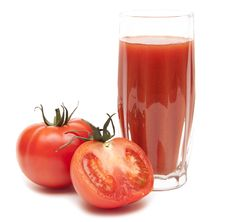 Fresh Tomatoes And A Glass Full Of Tomato Juice Stock Photo