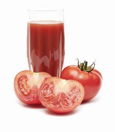 Fresh Tomatoes And A Glass Full Of Tomato Juice Stock Photos