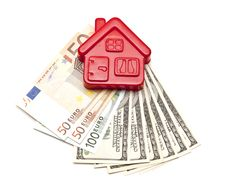 Free House On Top Of A Money Stock Photography - 17430802