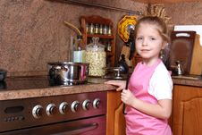 Free Girl Cooking In The Kitchen Stock Images - 17431964
