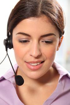 Free Beautiful Young Female Secretary Wearing Headset Royalty Free Stock Images - 17433029