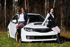 Free Two Beautiful Girls And Stylish White Sports Car Stock Photos - 17435693