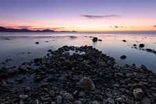 Free Colorful Sunrise On The Rocky Coast Royalty Free Stock Photography - 17439437