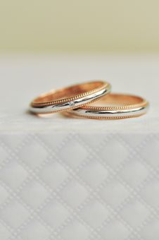 Pair Of Wedding Ring Sitting On Expensive Texture Royalty Free Stock Photo