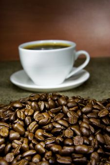Free Cup Of Coffee And Beans On Sack In Night Stock Image - 17441001