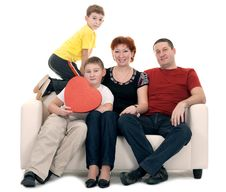 Free Family Silit On The Couch Stock Image - 17441341
